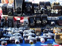 Old fashioned cameras on market stand Stock Image