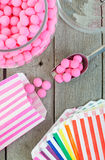 Old Fashioned Candy Treats. Old fashioned candy jar full of pink peppermints being distributed into individual candy bags royalty free stock images