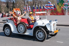 Old-fashioned car with animator in tiger costume Royalty Free Stock Photo