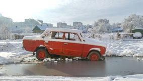 Old fashioned car near the water. Sunny winter weather around. royalty free stock photo