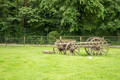 Old fashioned carriage left in an open field Royalty Free Stock Photo
