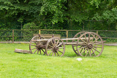 Old fashioned carriage left in an open field Royalty Free Stock Photos