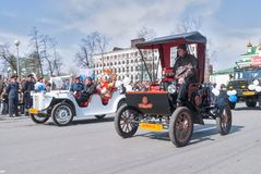 Old-fashioned cars participate in parade Stock Photography