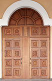 Old-fashioned carved door Stock Images