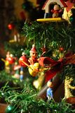 Old Fashioned Christmas Ornaments on a Tree. Antique looking toy christmas ornaments on a tree. Like: a toy santa on a flying duck-etc Royalty Free Stock Images