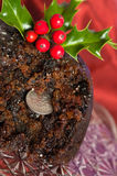 Old Fashioned Christmas Pudding. Close up of old fashioned Christmas pudding with sixpence coin Royalty Free Stock Photos