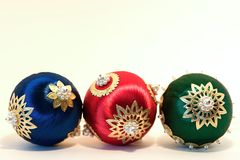 Old fashioned Christmas tree balls. Tre nostalgic handcrafted christmas tree balls arranged in a row Royalty Free Stock Photo