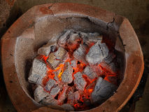 Old fashioned clay stove with charcoal Stock Photo