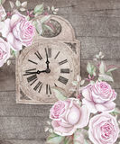 Old-fashioned clock with pink roses on wooden background. Watercolors Stock Photo