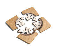 Old-fashioned clock print on puzzle pieces. 3d rendering of close-up of four puzzle pieces with print of old-fashioned shabby clock on paper background Royalty Free Stock Photo
