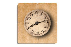 Old-fashioned clock print on puzzle pieces. 3d rendering of close-up of four puzzle pieces with print of old-fashioned shabby clock on paper background Stock Image