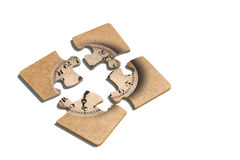 Old-fashioned clock print on puzzle pieces. 3d rendering of close-up of four puzzle pieces with print of old-fashioned shabby clock on paper background Royalty Free Stock Photography