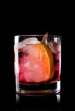 Old fashioned cocktail. On the black background Stock Image