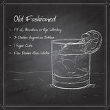 Old fashioned cocktail on black board Stock Photography