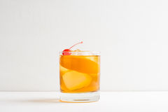 Old fashioned cocktail. With cherry and orange peel Stock Photography