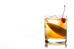 Old fashioned cocktail. With cherry and orange peel Stock Images