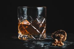 Old fashioned cocktail on dark background. Horizontal, with copy space royalty free stock photography