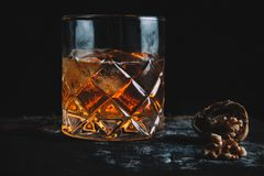 Old fashioned cocktail on dark background. Horizontal with copy space royalty free stock image
