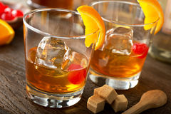 Old Fashioned Cocktail. Delicious old fashioned cocktails with bourbon, bitters, sugar, orange, and maraschino cherry Stock Photos