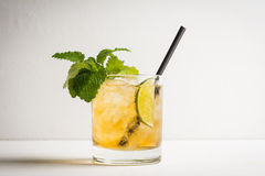 Old fashioned cocktail with lime and mint. On the wooden table Stock Photo