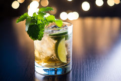 Old fashioned cocktail with lime and mint. On the wooden table Stock Photos