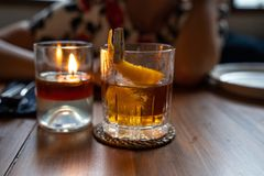 Old fashioned cocktail served in a whiskey glass at the restaurant. Copy space stock photography