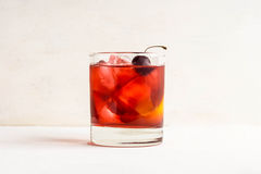 Old fashioned cocktail. On white wooden background Stock Photography