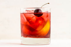 Old fashioned cocktail. On white wooden background Royalty Free Stock Photography