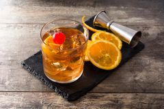 Free Old Fashioned Cocktail With Orange And Cherry On Wooden Table Royalty Free Stock Images - 144291719