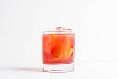 Old fashioned cocktail. On the wooden background Stock Images