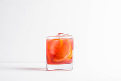 Old fashioned cocktail. On the wooden background Royalty Free Stock Images