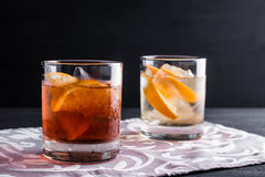 Old fashioned cocktails. On the wooden background Stock Images