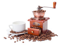 Old fashioned coffee ginder with cup and beans stock photos