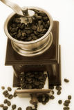 Old fashioned coffee grinder. Aged photo form an old fashioned coffee grinder and coffee beans Stock Images