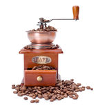 Old fashioned coffee grinder with beans Stock Photo