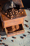 Old fashioned coffee grinder and coffee beans Stock Photo
