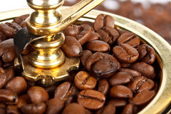 Old-fashioned coffee grinder and coffee beans Royalty Free Stock Photos