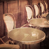 Old-fashioned coffee terrace with tables and chairs,paris France Stock Images