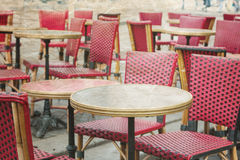 Old-fashioned coffee terrace with tables and chairs,paris France Royalty Free Stock Images