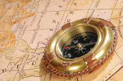 Old-fashioned compass on an old map Royalty Free Stock Image