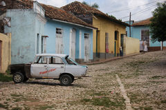 Old fashioned Cuban car in the street of Trinidad Stock Photos