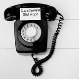 Old fashioned customer service concept. Black and white retro telephone, great old fashioned customer service concept, service like it used to be Royalty Free Stock Image