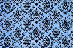 Old fashioned  damask repeat pattern background. A closeup of a lovely antique fashioned shabby  chic damask pattern printed on a paper background Royalty Free Stock Images