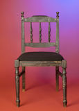 Old-fashioned dark wood chair Stock Photos