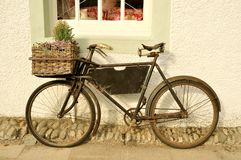 Old Fashioned Delivery Bicycle. An old fashioned delivery bicycle leaning against a wall in the UK Royalty Free Stock Photography