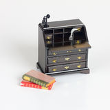 Old fashioned desk with phone and quill Royalty Free Stock Images