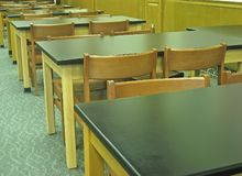 Old-fashioned desks and chairs. Royalty Free Stock Images