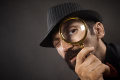 Detective with loupe stock photography