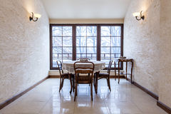 Old-fashioned dining room in luxury stylish mansion Royalty Free Stock Photos