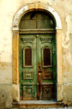 Old fashioned door. Details of old fashioned door in building Royalty Free Stock Photo